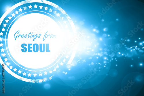 Blue stamp on a glittering background: Greetings from seoul Poster
