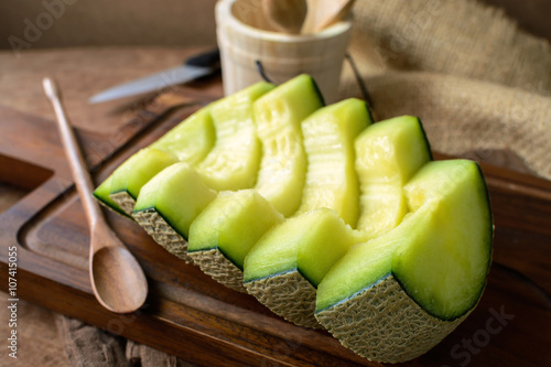 Juicy slice melon on a wooden table