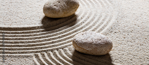 Tuinposter Stenen in het Zand zen sand still-life - stones set across sinuous waves for concept of different directions or change with inner peace