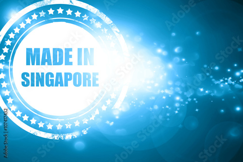Photo  Blue stamp on a glittering background: Made in singapore