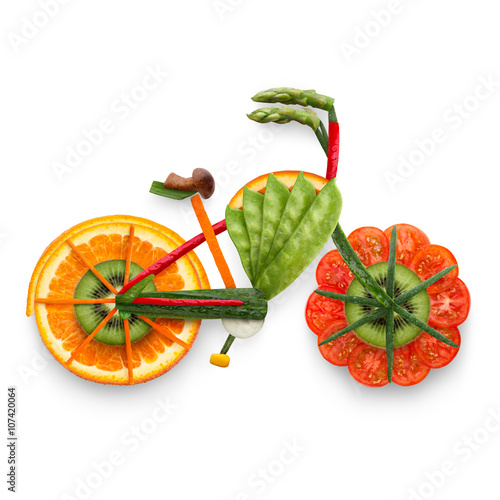 Fototapety, obrazy: Fruity e-bike / Healthy food concept of an electric bicycle in detail made of fresh vegetables and fruits full of vitamins, isolated on white.
