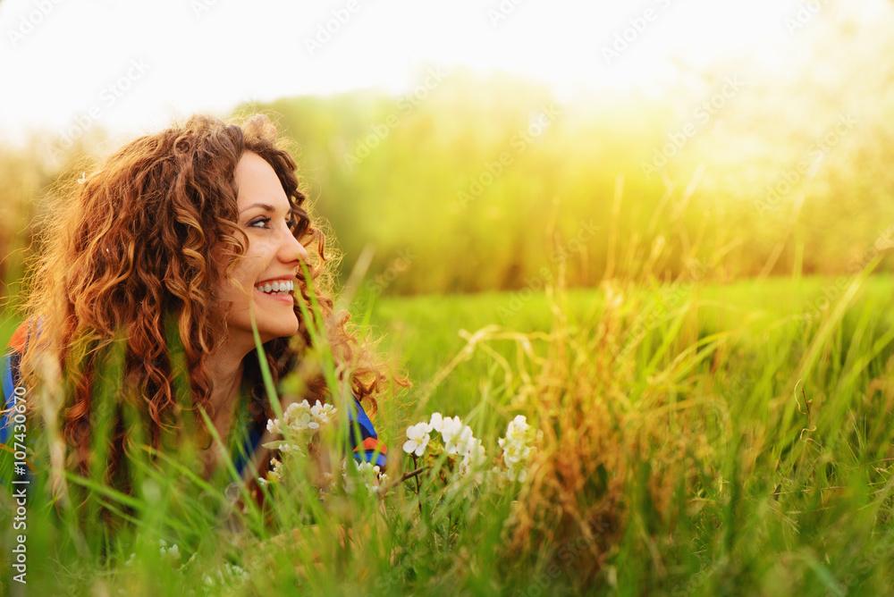 Fototapeta Pretty smiling girl relaxing outdoor