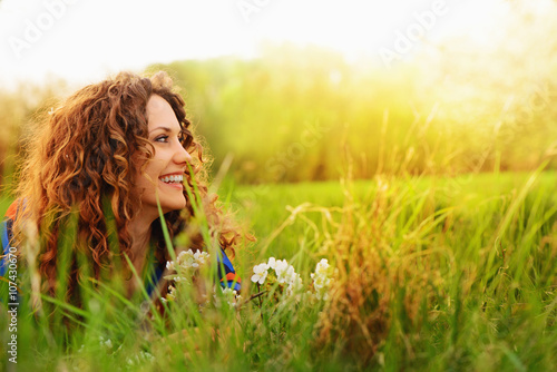 Obraz Pretty smiling girl relaxing outdoor - fototapety do salonu