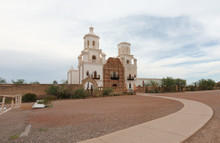Mission San Xavier Del Bac On A Cloudy Day. Mission San Xavier Del Bac Is A Historic Spanish Catholic Mission Located At Tucson, Arizona.