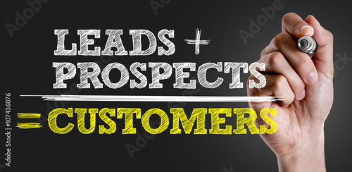 Fotografie, Obraz  Hand writing the text: Leads + Prospects = Customers