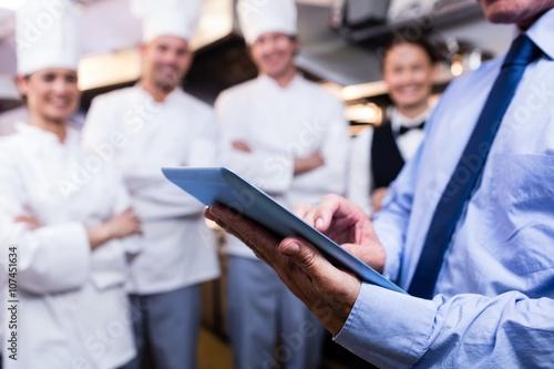 Fotografía  Mid section of manager using digital tablet