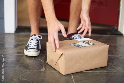 Stampe  Close Up Of Man Collecting Parcel Delivery Outside Door