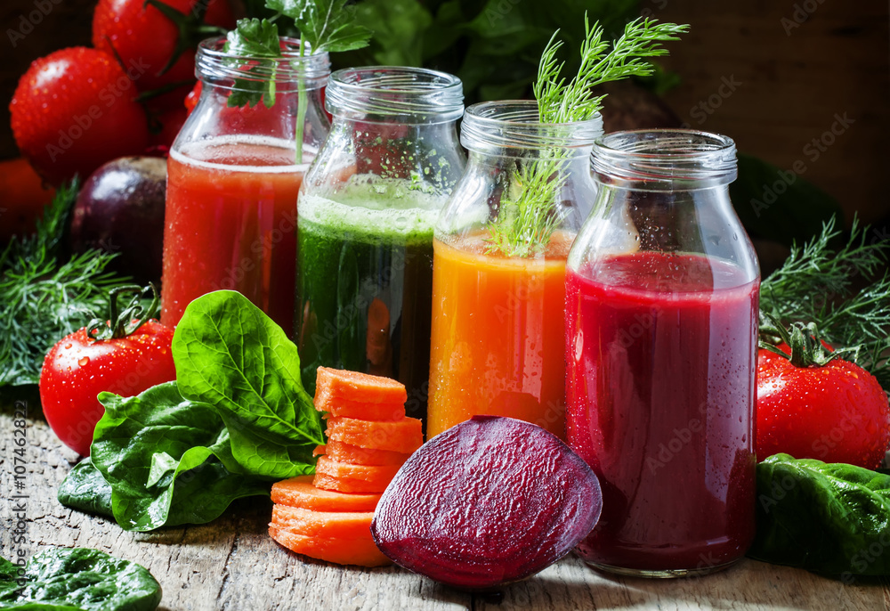 Fototapeta Four kind of vegetable juices: red, burgundy, orange, green, in