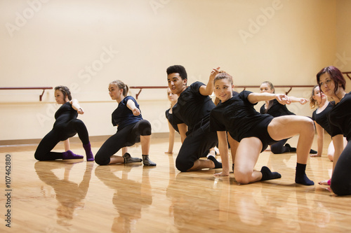 Teenage dancers rehearsing in studio Poster