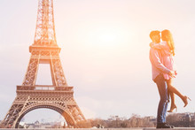 Love In The Most Romantic City - Paris, Young Couple At Eiffel Tower And Vanilla Sky