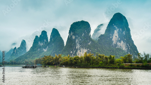Low-lying Clouds and Limestone Outcrops by the Li River - Guilin, China