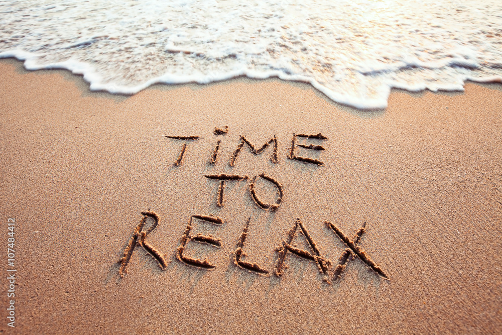 Fototapeta time to relax, concept written on sandy beach