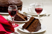 Chocolate Cake And Glasses Of Wine.