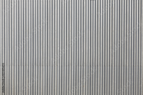 Foto  Corrugated metal roof picture taken from above, industrial background or texture