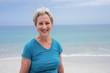 Portrait of happy senior woman on beach