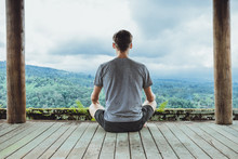 Young Fashionable Man Meditating In The Gazebo On The Background