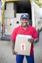 Black Delivery Man Holding Package