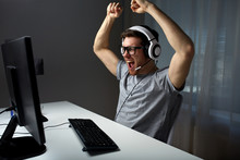 Man In Headset Playing Compute...
