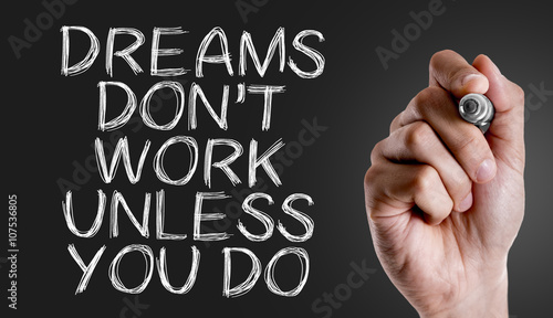 Photo  Hand writing the text: Dreams Don't Work Unless You Do