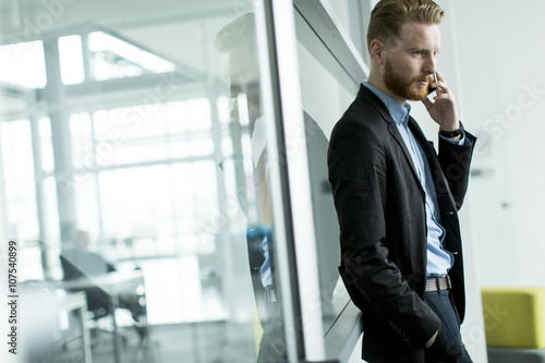 Fototapety, obrazy: Businessman on a phone