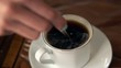 Female hand mixing black coffee with spoon, super slow motion 240fps