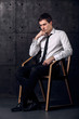Successful businessman on a chair is thinking about his business