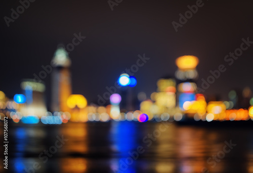 Background of night city skyline reflected in water