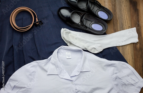 Fotografía  Still life : Thai Student girl uniform with wooden background on top view