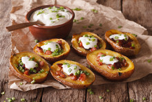 Rustic Potato Skins With Cheese, Bacon And Sour Cream Close-up