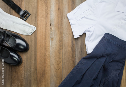 Fotografie, Obraz  Still life : Thai Student girl uniform with wooden background on top view