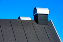 Rooftop With Covered Chimneys....