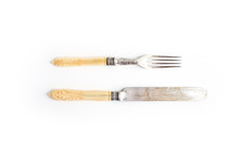 Set Of Vintage Dinnerware. Knife And Fork With Bone Handles On A White Background. Top View.