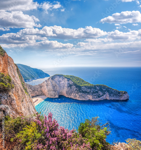 Obraz Navagio beach with shipwreck and flowers against sunset on Zakynthos island in Greece - fototapety do salonu