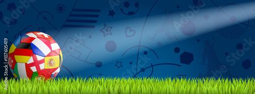 Photo  bunter EM Ball vor blauem Hintergrund auf Rasen