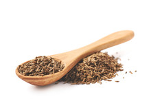 Wooden Spoon Over The Pile Of Cumin