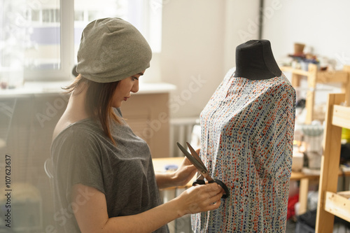Fotografia, Obraz  The dressmaker is a dummy and holding a pair of scissors in the Studio