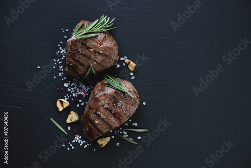 Top view of grilled filet mignon steaks, black wooden surface Wallpaper Mural