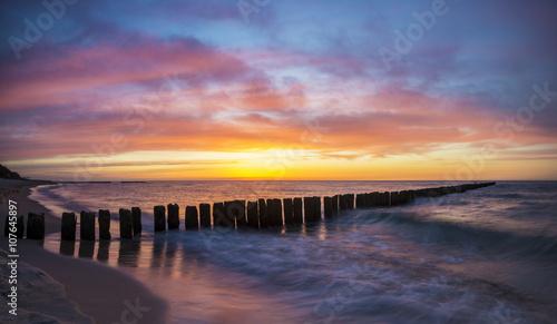 Garden Poster Light pink sunset over the sea beach