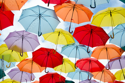 Fototapeta Colorful umbrellas floating obraz