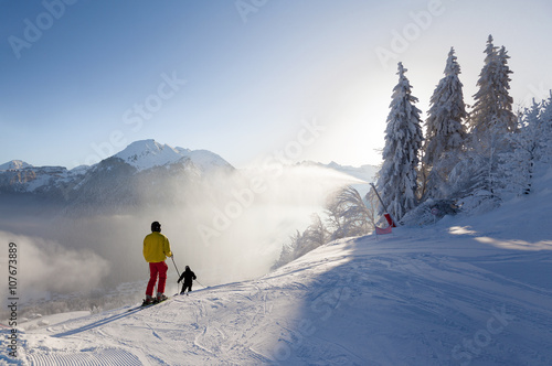 Fototapeta Skiers Setting off on a Piste in Morzine, France