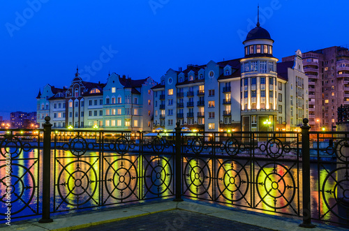 Fotomural  Ethnographic and trade center, embankment of the Fishing Village, night view, Kaliningrad, Russia