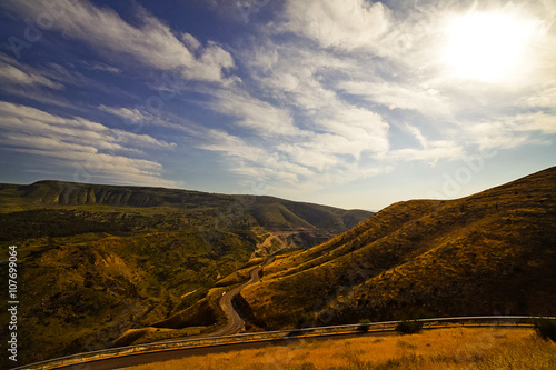 The twisting road in the mountains #107699064