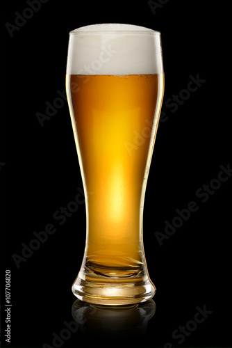 Glass of beer on black Canvas Print