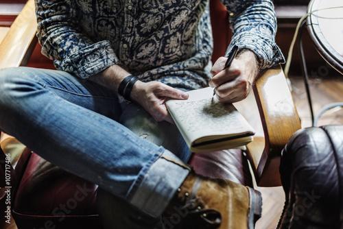 Valokuva  Man Writing Diary Relax Concept