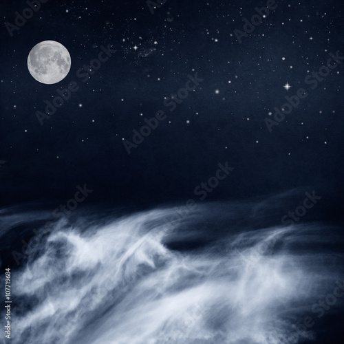 Fotobehang - Black and White Clouds and Moon with stars at night. Image has a pleasing paper grain and texture when viewed at 100 percent.