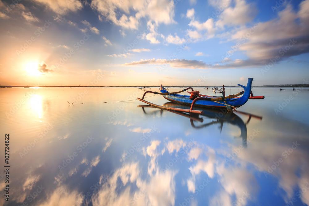 Fototapeta morning sun in Bali, Indonesia. Traditional fishing boats at Sanur beach