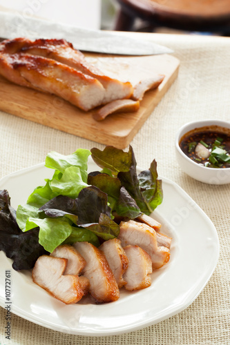 cut pork chop and vegetable in plate with spicy sauce,thai