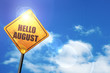canvas print picture - Yellow road sign with a blue sky and white clouds: hello august