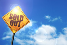 Yellow Road Sign With A Blue Sky And White Clouds: Sold Out