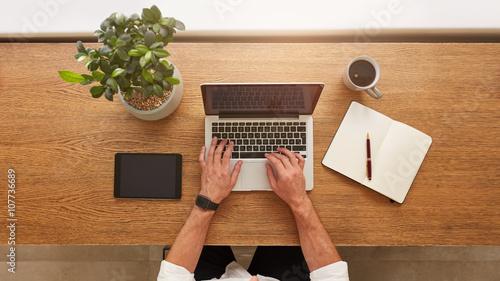 Fényképezés  Man working on laptop from home